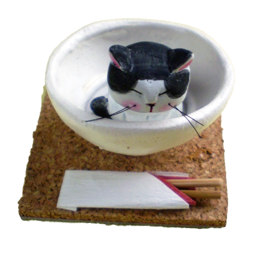 A cat of great capacity in a bowl of small capacity!